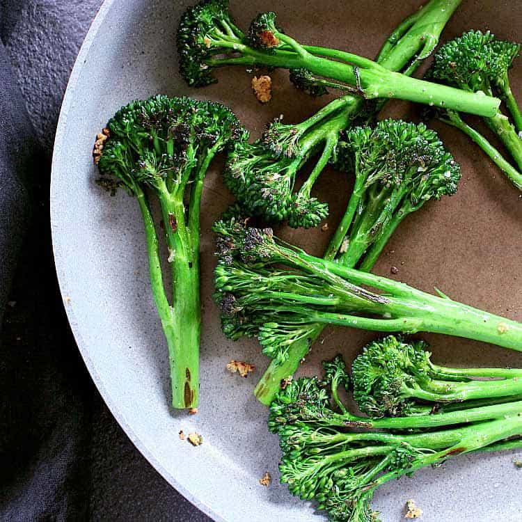 Skillet full of sautéed broccolini.