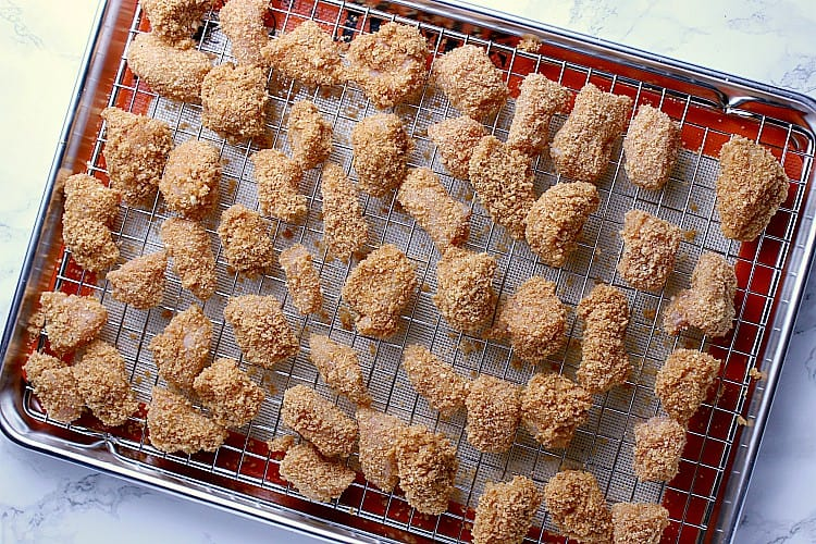 Breaded chicken ready for the oven.