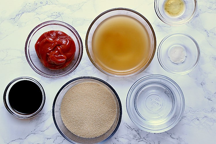 A dish of each: sesame oil, xanthan gum, water, apple cider vinegar, almond flour, ketchup and soy sauce.
