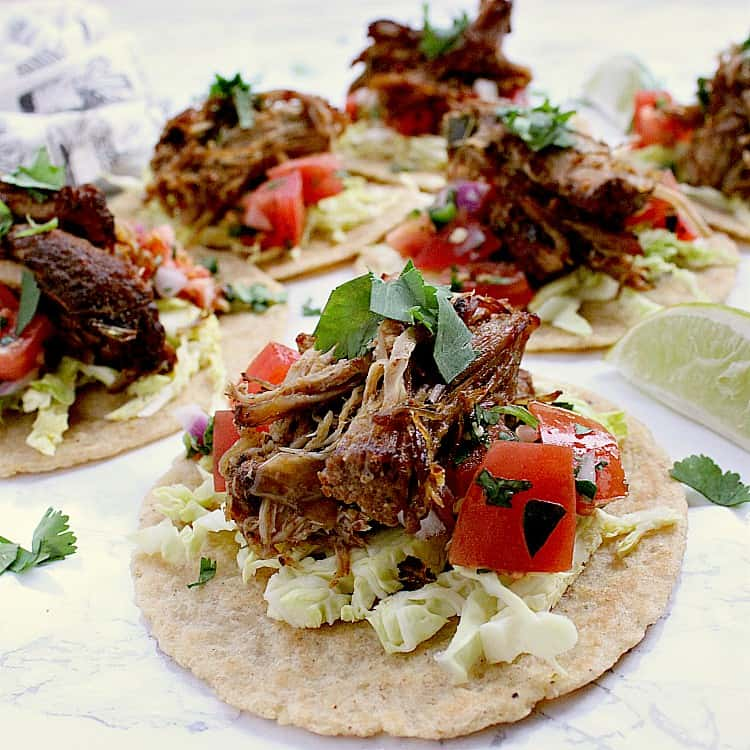 Almond flour tortillas filled with toppings and keto carnitas.