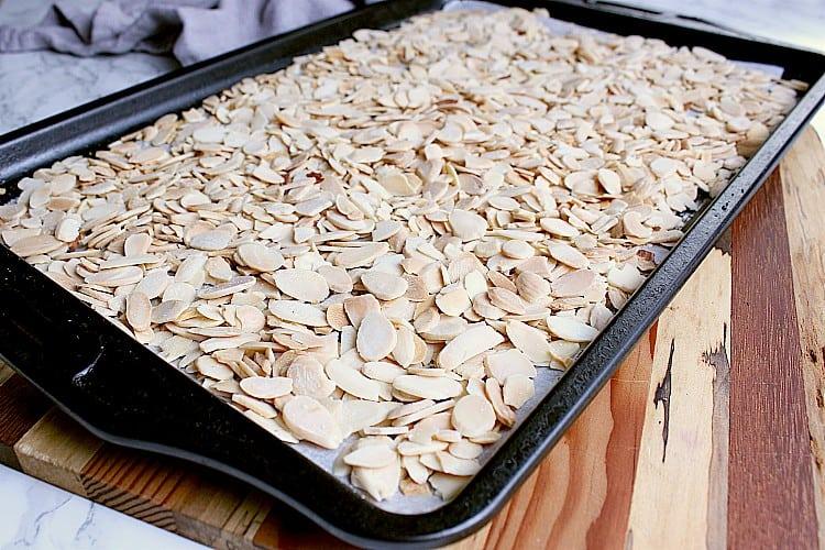 Baking sheet with freshly roasted sliced almonds.