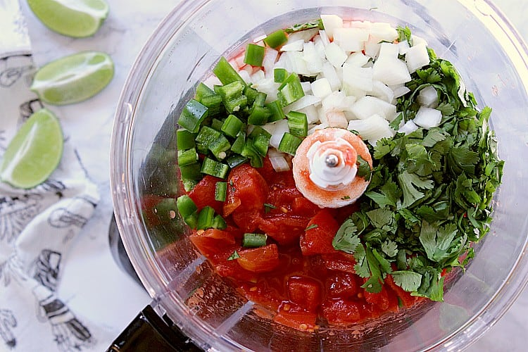 Salsa ingredients in a food processor.