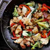 Cast iron wok with keto chicken stir fry, ready to be served.