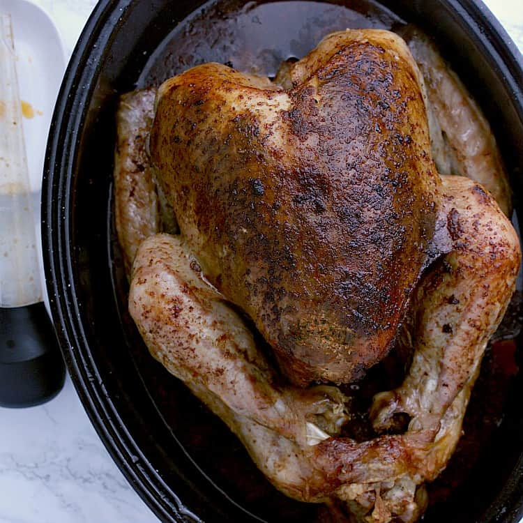 Roasted Keto turkey fresh from the oven, still in the roasting pan.