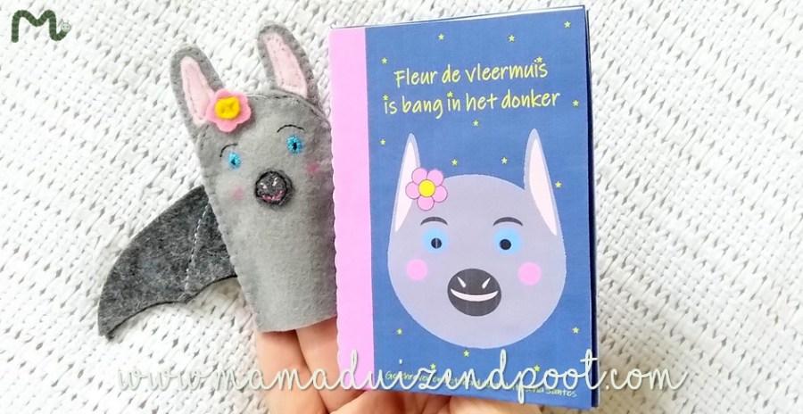 Een miniboekje met bijbehorend vingerpoppetje