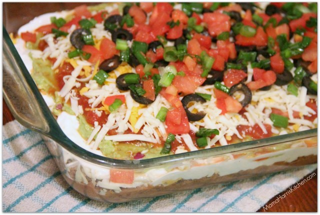 "7 layer Dip, perfect for the Big Day! Part of Mama Harris' Kitchen 3 ""Must-Have"" Foods for the Big Game!"