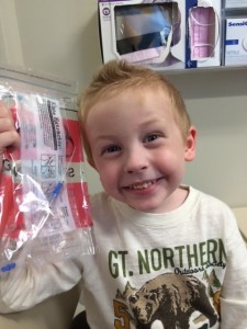 One relieved Jordan with his tool and Lego piece!