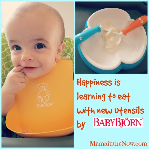 Happiness is learning to eat with new utensils by BabyBjorn