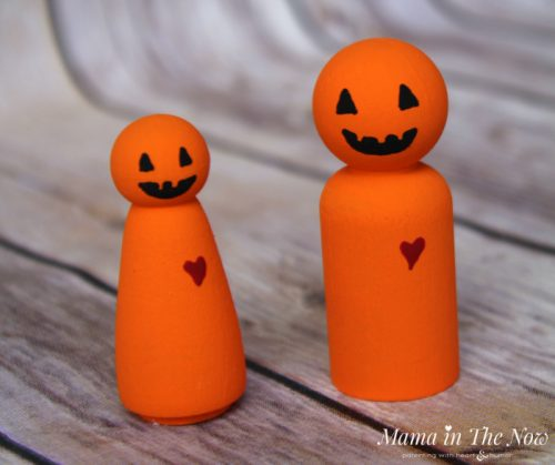 How to make friendly Halloween Jack O'Lantern wooden peg dolls. Adorable not-so-spooky kid-friendly Halloween decorations.
