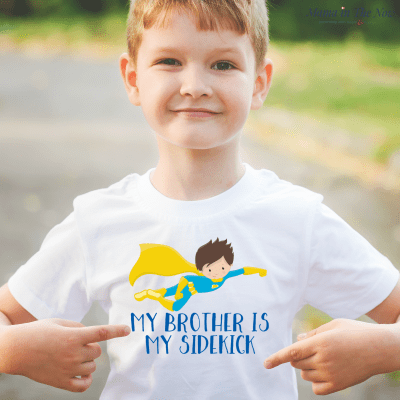 Celebrate a new baby brother like a true superhero. Brothers and Sisters are best friends, superhero and sidekick. Cute graphic tee shirt. Great gift, stocking stuffer for pregnancy announcement, big brother gift, gender reveal and new baby gift.