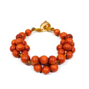 tani orange bracelet 1 - Tani orange wooden teething nursing fiddle bracelet
