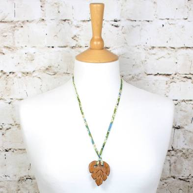 LEAF PENDANT TEETHING NECKLACE ON GREEN LIBERTY CORD 1 - Palm leaf pendant apple wood teething necklace on green Liberty cord