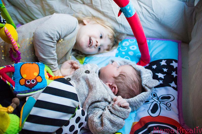 Wochenbett mit drei Kindern