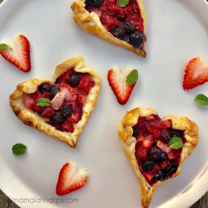 Heart shape berry tarts on a platter