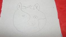 Sur l'intérieur, tu dessines, la tete de l'animal que tu souhaites faire