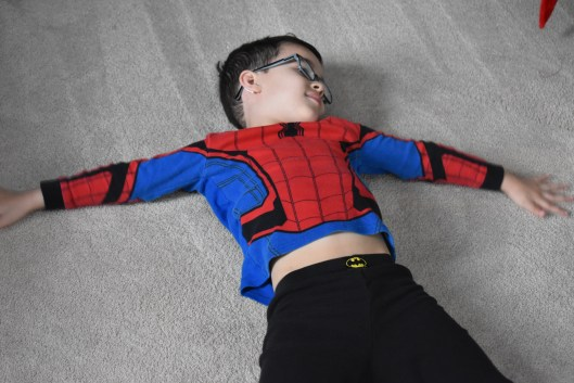 Noah exhausted after working on his DIY Superhero Room