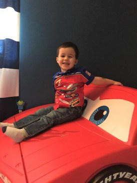 Noah on his Lightning McQueen Toddler Bed