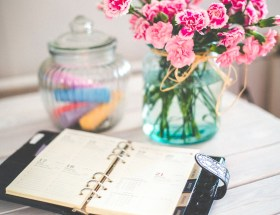 planner and vase with flowers