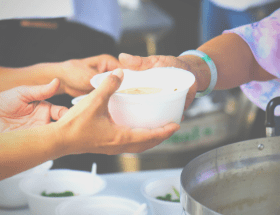 Ways to serve feature image of hands passing out soup