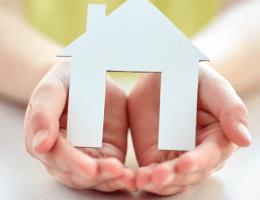 Cutout home in open hands. feature image for Prayers for the Home