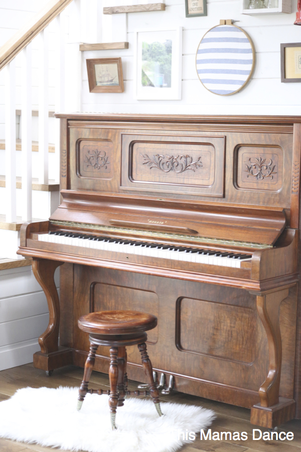 gallery wall and antique morris piano