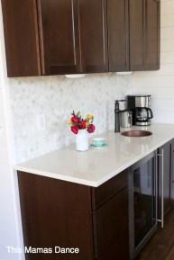 dark stained cabinets, hex marble backsplash
