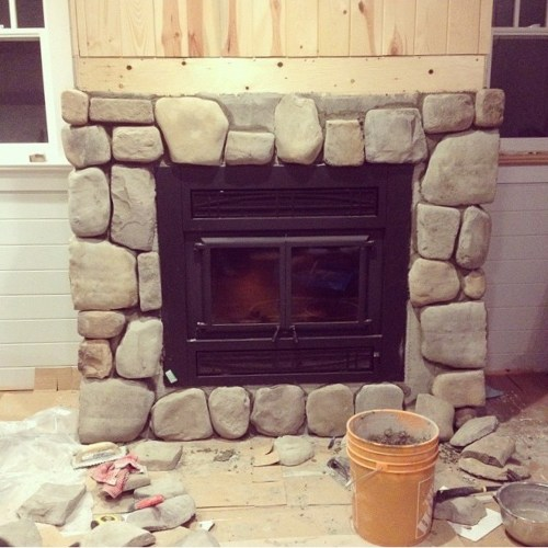 stone-face-fireplace-with-rustic-wood-mantel-1
