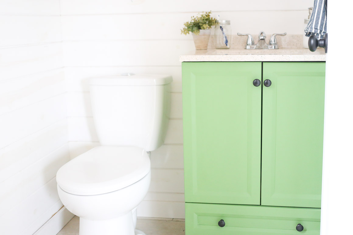 Seeing Green: Painted Bathroom Vanity - This Mamas Dance on painting cabinets white bathroom, a painting in a mobile home bathroom, refurbish bathroom, remove bathroom, taupe bathroom, paint bathroom, size bathroom, painting wood cabinets bathroom, redecorate bathroom, diy bathroom, add a bathroom, disabled bathroom, prepare for painting bathroom, update bathroom, cabinets stain colors for bathroom,