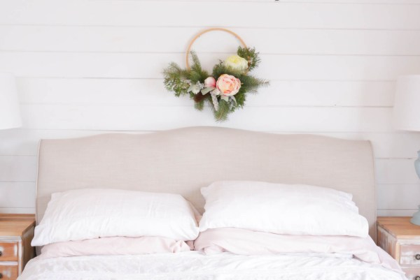 Upholstered bed frame, with white and pink linens | This Mamas Dance