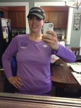 Purple New Balance top and black hat.