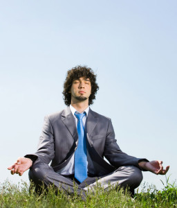 Man in business suit meditating