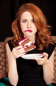Young woman  stress eating cake