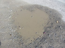 Kids and I were biking and my then 8 year old daughter stopped and pointed out this puddle in the shape of a heart. We just stared at it in silence, it was really neat – a perfect heart. It truly is moments like these that give me strength – and i think i can say for the kids, too. There are gifts in every moment, from every challenge comes a mud puddle in the shape of a heart to tell you that everything is ok and most importantly that someone is always with you.