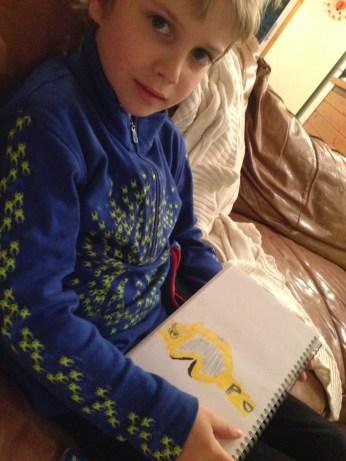 Drawing his ski goggles.