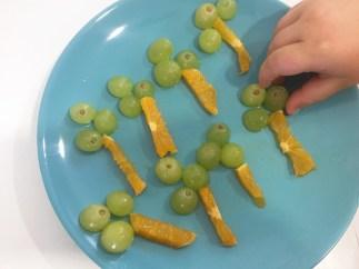 Árboles de Naranja y Uvas