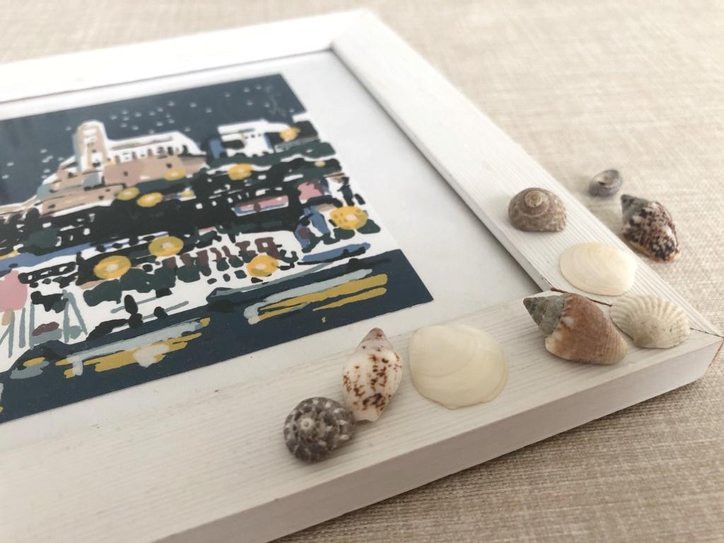 marco de fotos con conchas