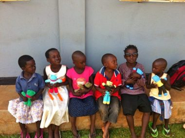Older children enjoying the knitted toys too