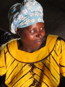Mother attending outreach clinics in bright yellow