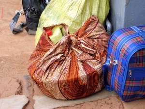 Mothers carry their delivery equipment wrapped in fabric on their heads. In there will be the basics for delivery a baby gloves, cotton wool, gauze, drugs, blade and covera or plastic sheet