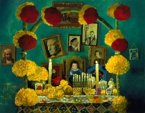 Painting of an altar with photographs, a menorah, and red and yellow flowers against a green wall