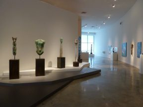 Installation shot of sculptures in a hallway at a museum