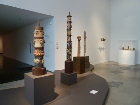 Installation shot of columnar sculptures in a museum