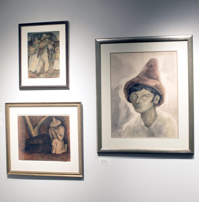 Installation shot of three watercolors hanging on a wall