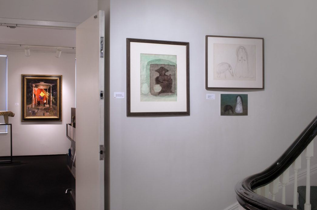 Installation shot of Leonora Carrington drawings in the gallery hallway