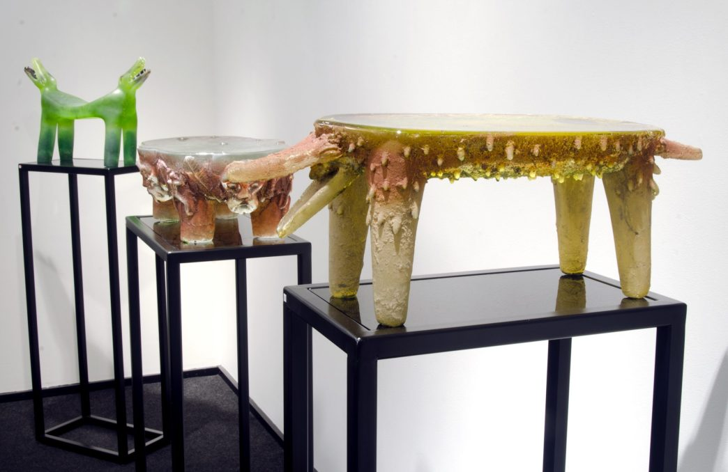 Installation shot of pre-Columbian inspired glass sculptures of animals