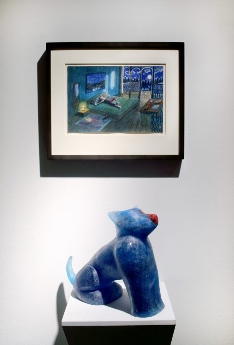 Picture of one watercolor hanging in the wall and a small blue sculpture underneath