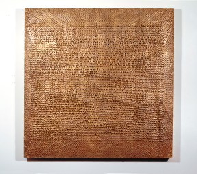 An artwork made of square gilded wood covered in puncture holes