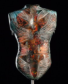 Blue, orange, and black glass sculpture of a torso with engraved stripes