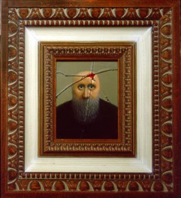 A bearded, bald man looks out from a frame whose glass is broken. The man's head bleeds, as if a bullet has penetrated the glass and wounded him in the head. The framed man sits inside a larger, identical frame.