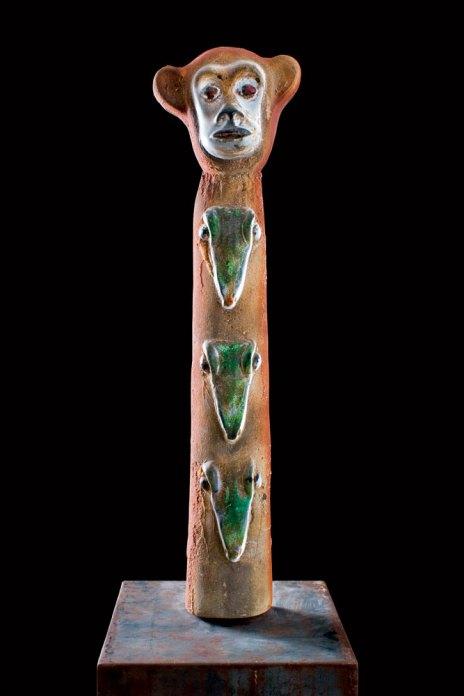 Glass sculpture of a monkey's head on a columnar body